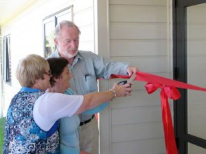 Patricia-McGavin-cutting-ribbon-with-John-Sutherland,-Jackie-Johnson-supporting,-Copeland-St-29Jan2013-030
